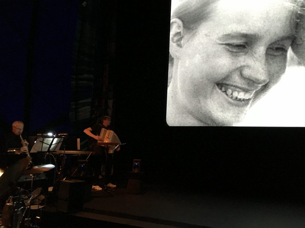 "John M. Davis playing accordion to the film ""The Man With a Movie Camera"" at the Museum of the Moving Image, Astoria, Queens, 2016"